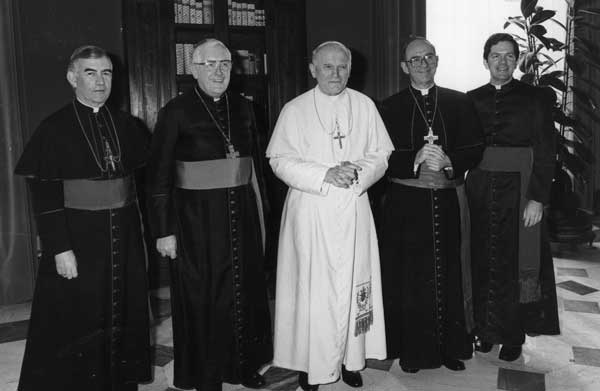 Pope John Paul II with Archbishop Joseph L. Bernardin, of Chicago &#40;2nd from right&#41;, Msgr. John R. Quinn, Archbishop of S. Francisco &#40;L&#41;, Msgr. James Malone, Bishop of Youngstown &#40;2nd from left&#41;, President of the American Episcopal Conference and Msgr. Daniel F. Hoye, Secretary of the Conference, during a private audience in the Vatican, Feb. 14, 1984.  <span class=meta>(&#40;AP Photo&#47;Arturo Mari&#41; )</span>